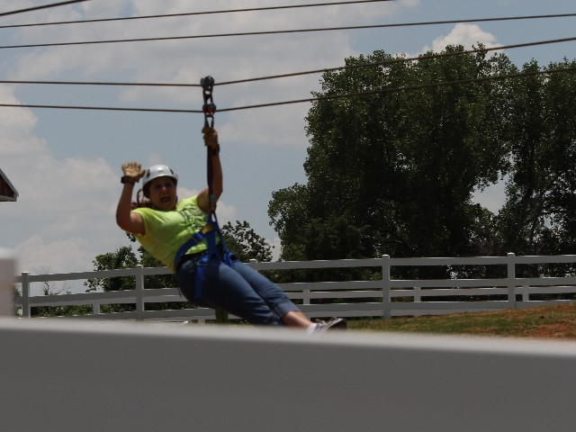 Christie Messick Shatswell Zip Lining at the Orr Family Farm <br/>